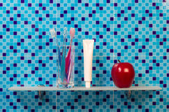 Toothbrushes on bathroom shelf Royalty Free Stock Image