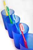 Toothbrushes in beakers Royalty Free Stock Photography