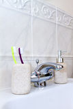 Toothbrushes in a clean white bathroom Royalty Free Stock Photos