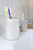 Toothbrushes in a clean white bathroom Royalty Free Stock Photography