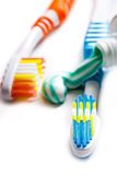 Toothbrushes closeup. Two colored toothbrushes with toothpaste closeup on white background Royalty Free Stock Image
