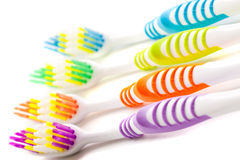 Toothbrushes closeup. Four colored toothbrushes, closeup on a white background Stock Photos