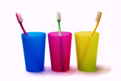 Toothbrushes in a color holders stock photos