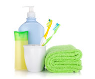 Toothbrushes, cosmetics bottles and towel Royalty Free Stock Image