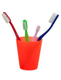 Toothbrushes and cup Stock Photos