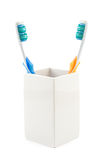 Toothbrushes in cup Stock Photos