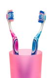 Toothbrushes in cup, close-up Stock Images