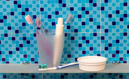 Toothbrushes and dentifrice on a shelf Stock Photo