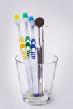 Toothbrushes in a glass Stock Photos