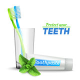 Toothbrushes In Glass  And Toothpaste Royalty Free Stock Photography