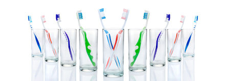Toothbrushes and glasses Royalty Free Stock Images