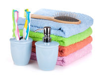 Toothbrushes, liquid soap, hairbrush and towels Stock Image