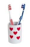 Toothbrushes para ele e para ela. Foto de Stock
