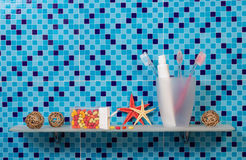 Toothbrushes and paste in cup Stock Images