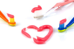Toothbrushes with pink toothpaste Royalty Free Stock Images