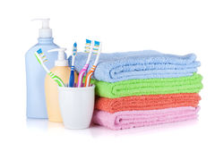 Toothbrushes, shampoo bottles and colored towels royalty free stock photography