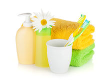 Toothbrushes, shampoo bottles, two towels and flowe Royalty Free Stock Photos