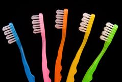 Toothbrushes side by side on a black background Royalty Free Stock Photos