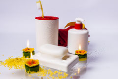 Toothbrushes, soap, liquid soap and red towel on w Royalty Free Stock Photos