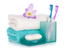 Toothbrushes, soap, two towels and flower Royalty Free Stock Photography