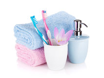 Toothbrushes, soap, two towels and flower Stock Photo