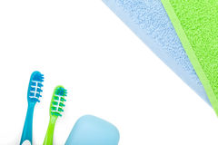 Toothbrushes, soap and two towels Royalty Free Stock Images