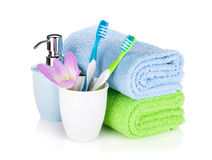 Toothbrushes, soap and two towels Stock Image
