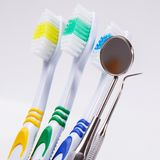 Toothbrushes on the table Stock Image