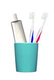 Toothbrushes and toothpaste in glass isolated on white Stock Photos