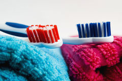 Toothbrushes and towels Stock Images