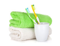 Toothbrushes and two towels Royalty Free Stock Photography