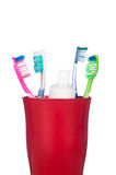 Toothbrushes in una tazza Immagine Stock