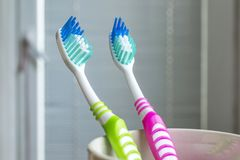Toothbrushes in the white cup. Toothbrush, Dental Care, Dental Health, Dental Equipment Royalty Free Stock Photos