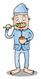 Toothbrushing before go to bed. Represent a man in pajama ready to go to sleep after brushing his teeth Royalty Free Stock Photos