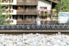 Toothed rack rail. Of the rack railway, also called rack-and-pinion railway in Zermatt, Switzerland. The trains are fitted with one or more cog wheels or royalty free stock photography
