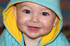 Toothless baby portrait. Cute toothless baby with hood on his head Stock Images