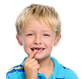 Toothless boy. Young blond child points to his missing teeth royalty free stock photos