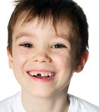 Toothless boy. Portrait of a smiling toothless boy on white background Royalty Free Stock Images