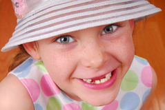 Toothless Girl in Hat Stock Photography