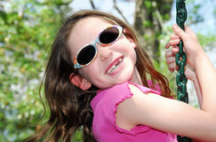 Toothless Girl on Swing Stock Images