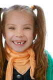 Toothless little girl. Beautiful toothless little girl laughs merrily close up Stock Image