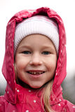 Toothless portrait. Closeup face of smiling funny little girl without one tooth Stock Photography