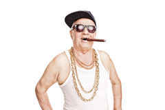 Toothless senior with a hip-hop cap smoking cigar Royalty Free Stock Photography