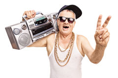 Toothless senior rapper holding a boombox. On his shoulder and gesturing with his hand isolated on white background stock photography