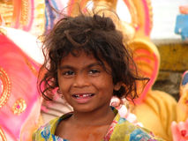 Toothless Smile. A poor toothless girl from India smiling Royalty Free Stock Image