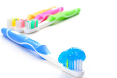 Toothpaste. Blue toothbrush loaded with toothpaste on a white background Royalty Free Stock Photo