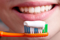 Toothpaste. Toothbrush, toothpaste and smiling woman Royalty Free Stock Image
