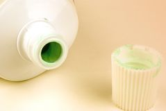 Toothpaste. A open tube of toothpaste with the lid next to it Stock Photos
