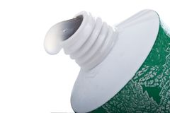 Toothpaste. Tube of toothpaste with drip of paste coming out from opening Stock Photos