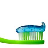 Toothpaste. Blue toothpaste on a green brush Royalty Free Stock Images